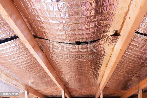 istock Reflective Radiant Heat Barriers Between Attic Joists Used as Ba 488277205