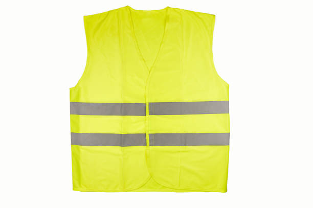 reflective vest Yellow vest isolated on black reflective clothing stock pictures, royalty-free photos & images
