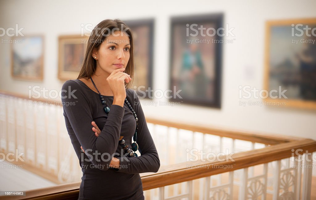 Reflective Woman in an Art Gallery (XXXL) stock photo
