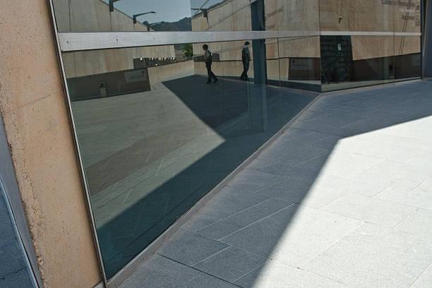 reflejos en edificio de oficinas - cartagena museum stock photos and pictures
