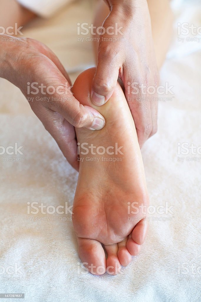 Reflexologist Therapeutic Foot Massage royalty-free stock photo