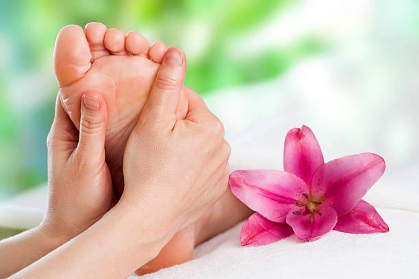 Reflexology massage. stock photo