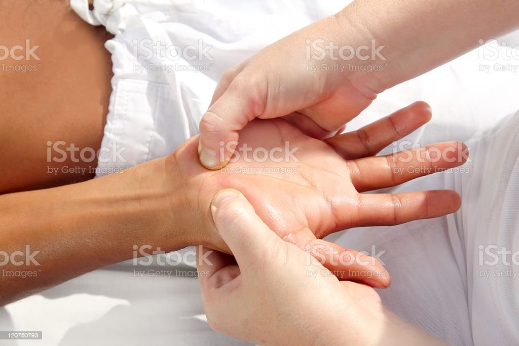Reflexology massage uses pressure on hands for tuina therapy royalty-free stock photo