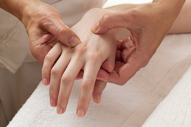 reflexology on hands for relaxation stock photo
