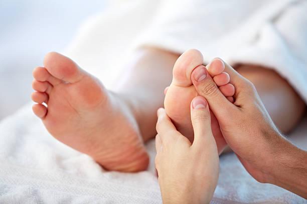 Reflexology Reflexology foot massage foot massage stock pictures, royalty-free photos & images