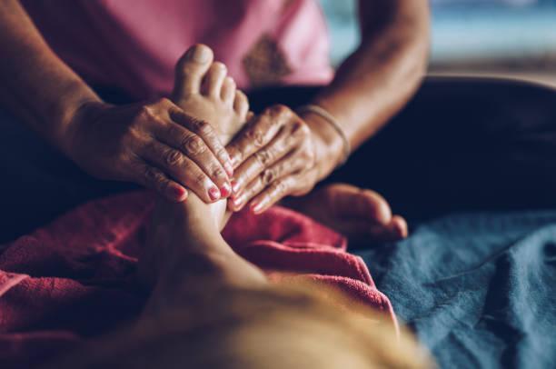 reflexology thai massage! - thai massage stock photos and pictures