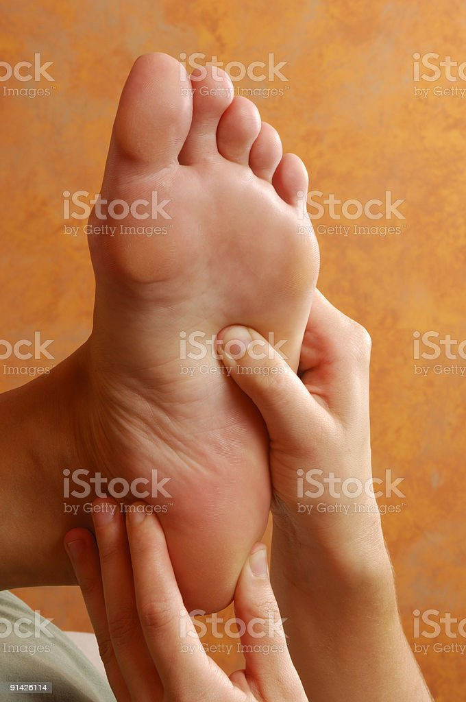 Reflexology Therapeutic Foot Massage At Spa royalty-free stock photo