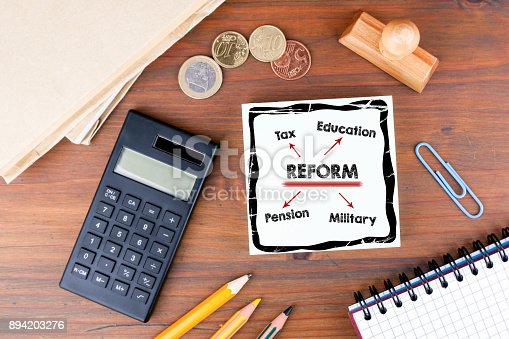 istock reform concept. Office desk with stationery, chart and communication background 894203276