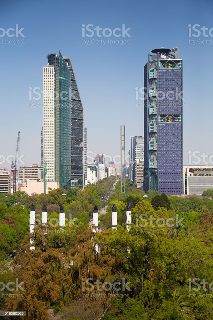 Reforma Avenue is lined with tall buildings stock photo