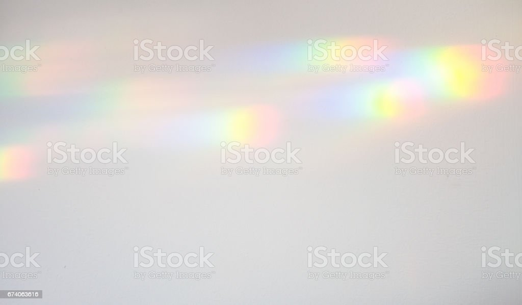 Refracted light creating colour spectrum patterns stock photo