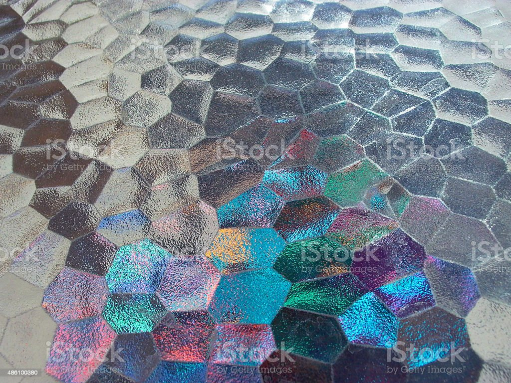refracted light off colored glass stock photo