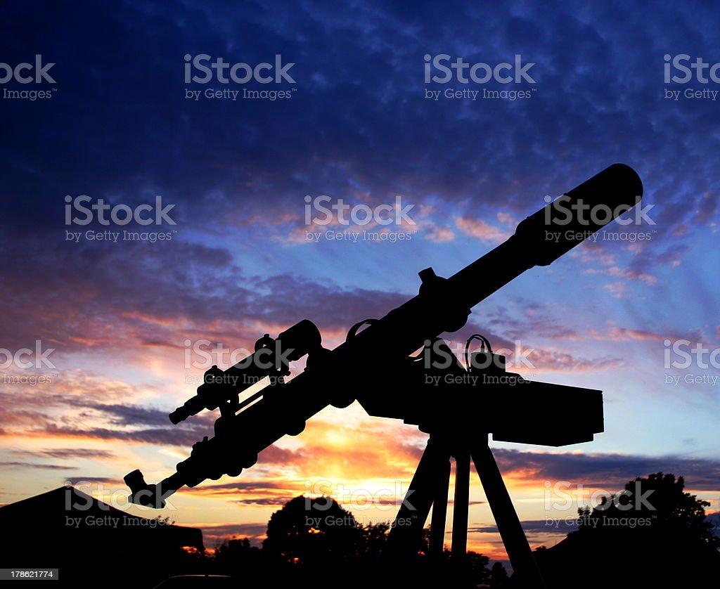 Refractor Telewscope in the dawn sky stock photo
