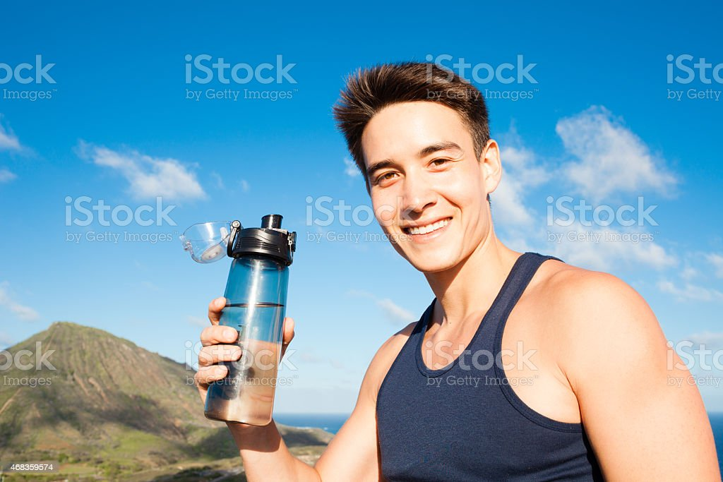 Refresh with a bottle of water royalty-free stock photo