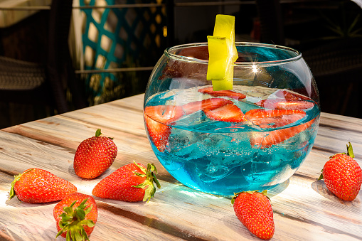 refreshing blue drink, cold drink with strawberries, tasty iced drink, strawberry drink with kiwi, very tasty restaurant drink