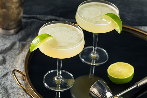 Refreshing Boozy Gin Gimlet Cocktail with a Lime Garnish