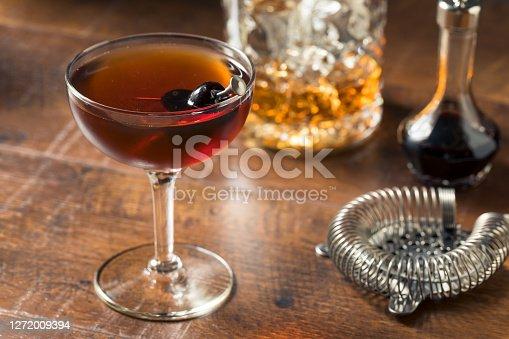 Refreshing Boozy Manhattan Cocktail with Vermouth and Cherry Garnish