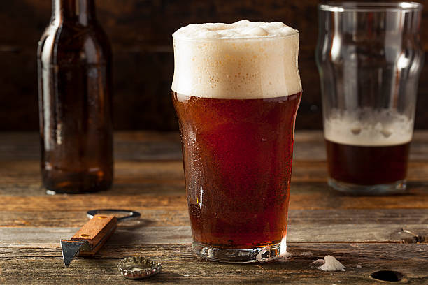 refreshing brown ale beer - dark beer stock photos and pictures