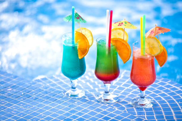 Refreshing cocktail drinks by the swimming pool stock photo