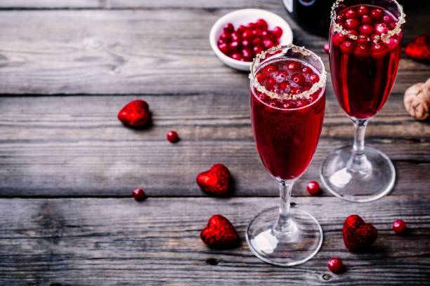 Refreshing cocktail with champagne and cranberry for Valentine's day stock photo