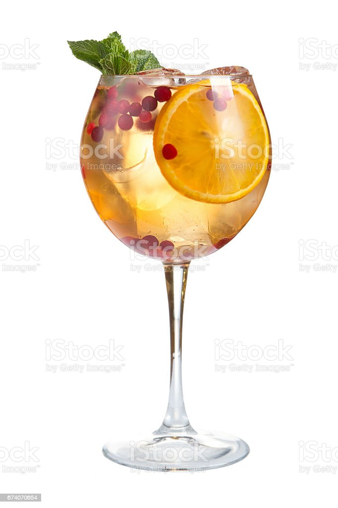 Refreshing cocktail with ice fruit juice and cranberries on a white background stock photo