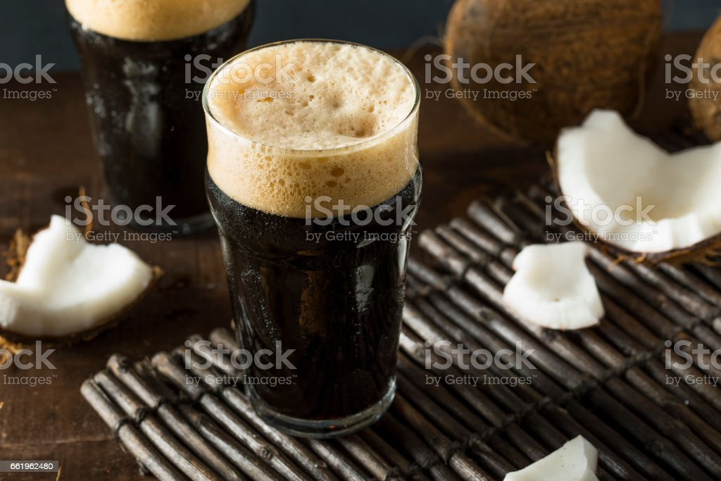 Refreshing Cold Dark Coconut Beer royalty-free stock photo