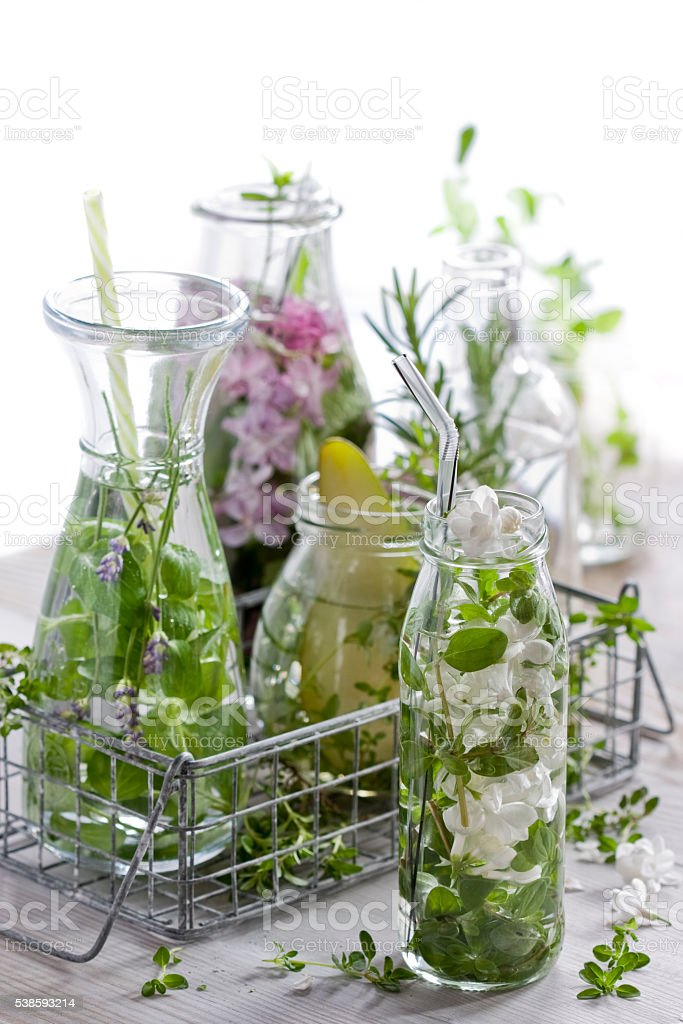 Refreshing drinks with herbs and edible flowers stock photo