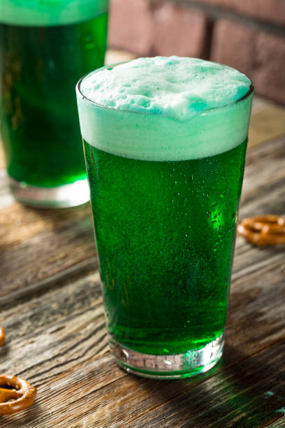 refreshing festive green beer - st patricks days stock photos and pictures