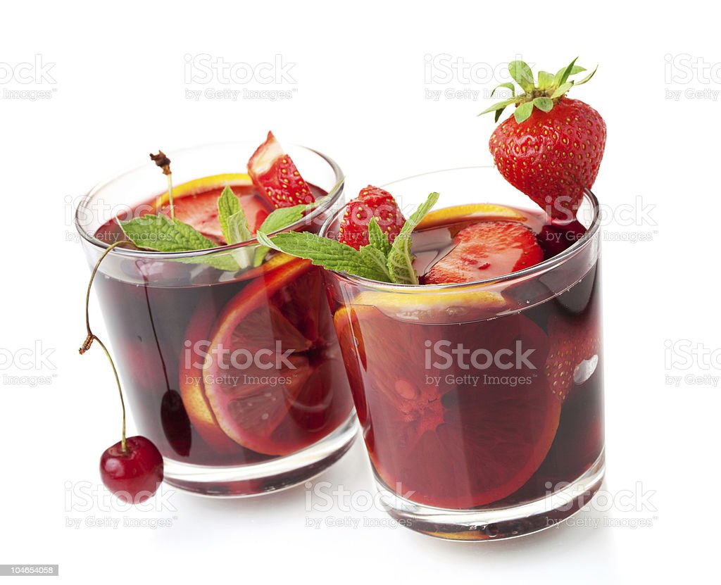 Refreshing fruit sangria in two glasses royalty-free stock photo