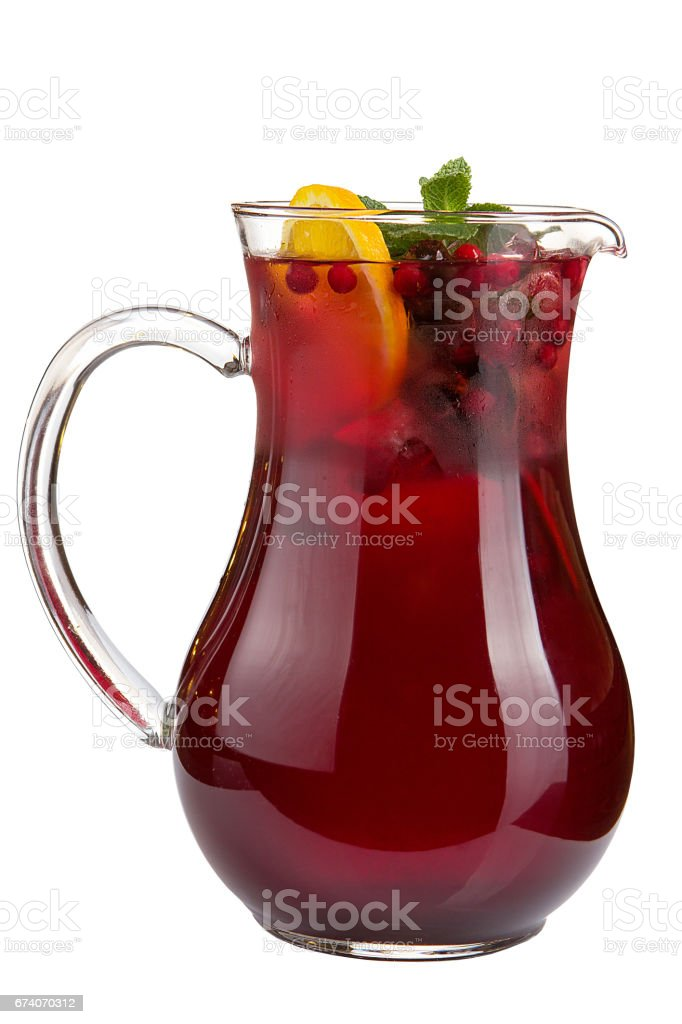 Refreshing fruit water in a decanter on a white background royalty-free stock photo