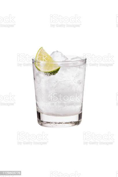 Photo of Refreshing Gin and Tonic on White
