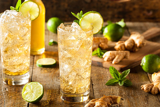 refreshing golden ginger beer - ginger stock photos and pictures