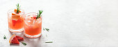 istock Refreshing grapefruit cocktail with ice and rosemary. 1286332118