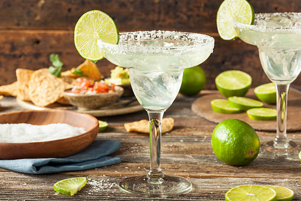 refreshing homemade classic margarita - margarita drink stock photos and pictures
