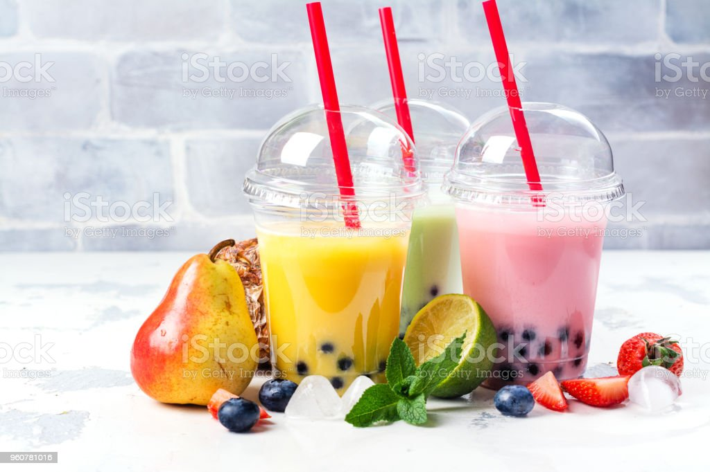 Refreshing homemade iced milky bubble tea with tapioca pearls stock photo