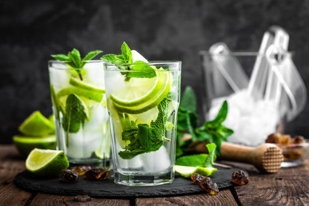 Refreshing mint cocktail mojito with rum and lime, cold drink or beverage with ice Refreshing mint cocktail mojito with rum and lime, cold drink or beverage with ice mojito stock pictures, royalty-free photos & images