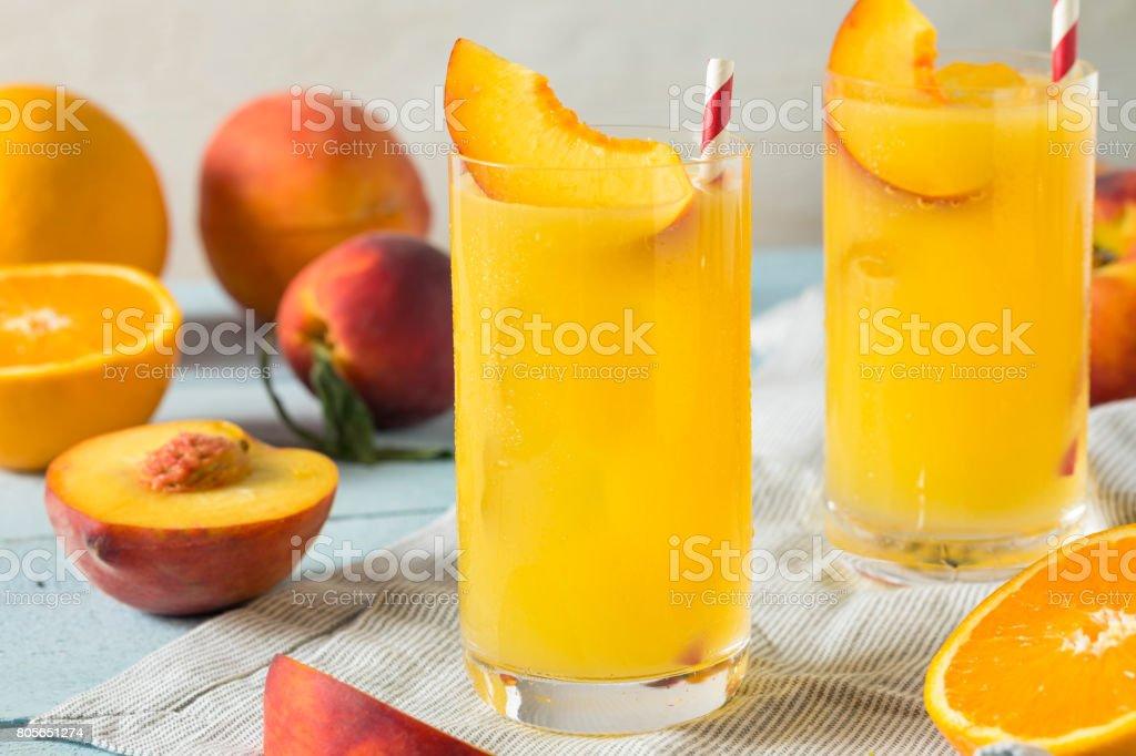 Refreshing Peach and Orange Fuzzy Navel Cocktail stock photo