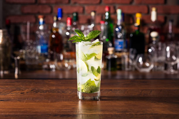 Refreshing Rum Mint Mojito Cocktail Refreshing Rum Mint Mojito Cocktail on a Table mojito stock pictures, royalty-free photos & images