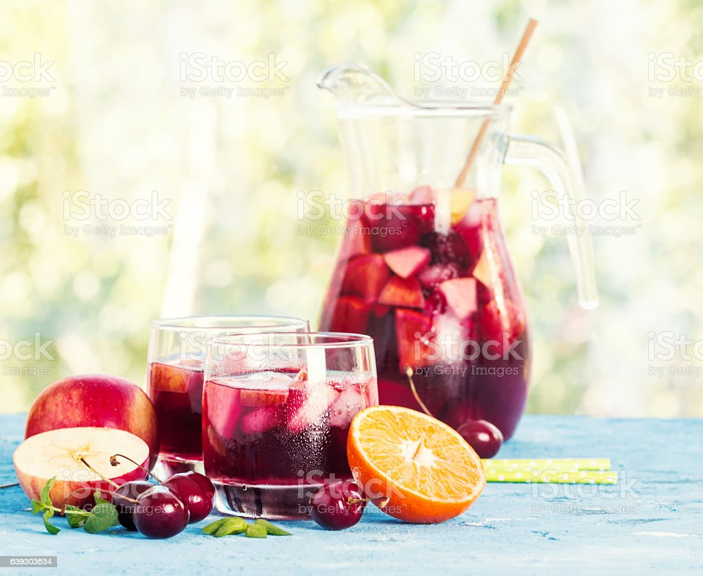 Refreshing sangria or punch with fruit stock photo