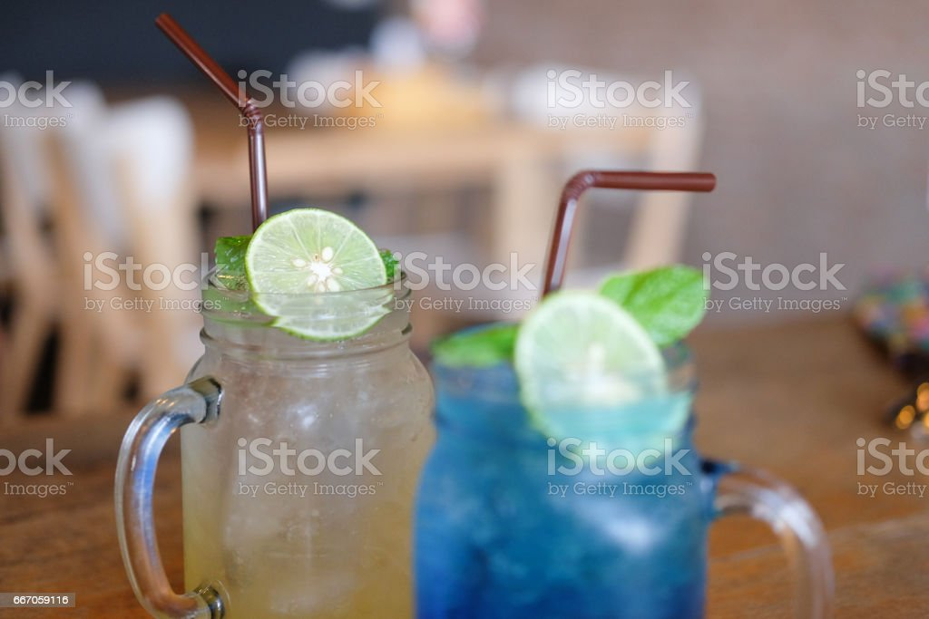 Refreshing summer homemade cocktail on wood table stock photo