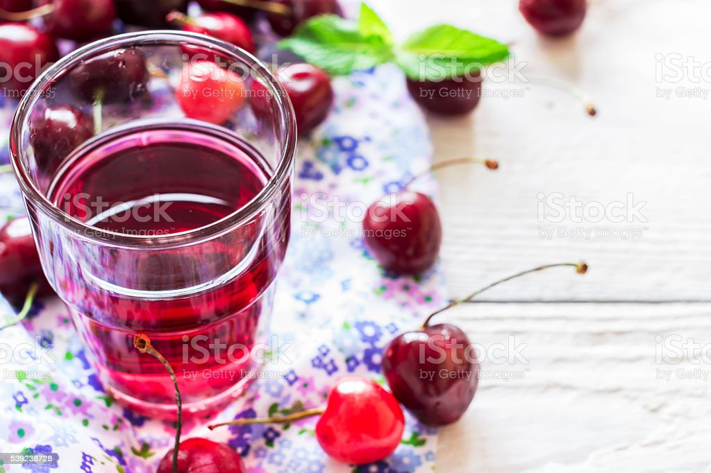 Refreshing summer homemade cocktail with cherry and mint. royalty-free stock photo