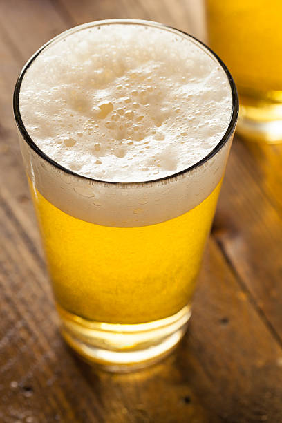 Refreshing Summer Pint of Beer Refreshing Summer Pint of Beer Ready to Drink pilsner stock pictures, royalty-free photos & images