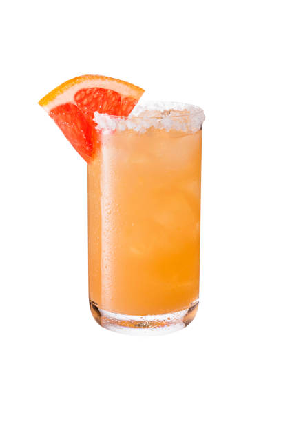 refreshing tequila paloma cocktail on white - grapefruit cocktail stock photos and pictures