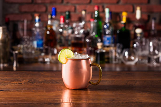 Refreshing Vodka Moscow Mule Cocktail Refreshing Vodka Moscow Mule Cocktail on a Bar moscow russia stock pictures, royalty-free photos & images