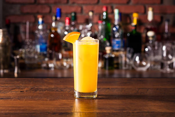 Refreshing Vodka OJ Screwdriver Cocktail Refreshing Vodka OJ Screwdriver Cocktail on a Bar screwdriver drink stock pictures, royalty-free photos & images