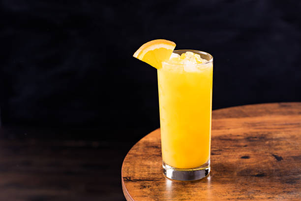 Refreshing Vodka OJ Screwdriver Cocktail Refreshing Vodka OJ Screwdriver Cocktail on a Table screwdriver drink stock pictures, royalty-free photos & images