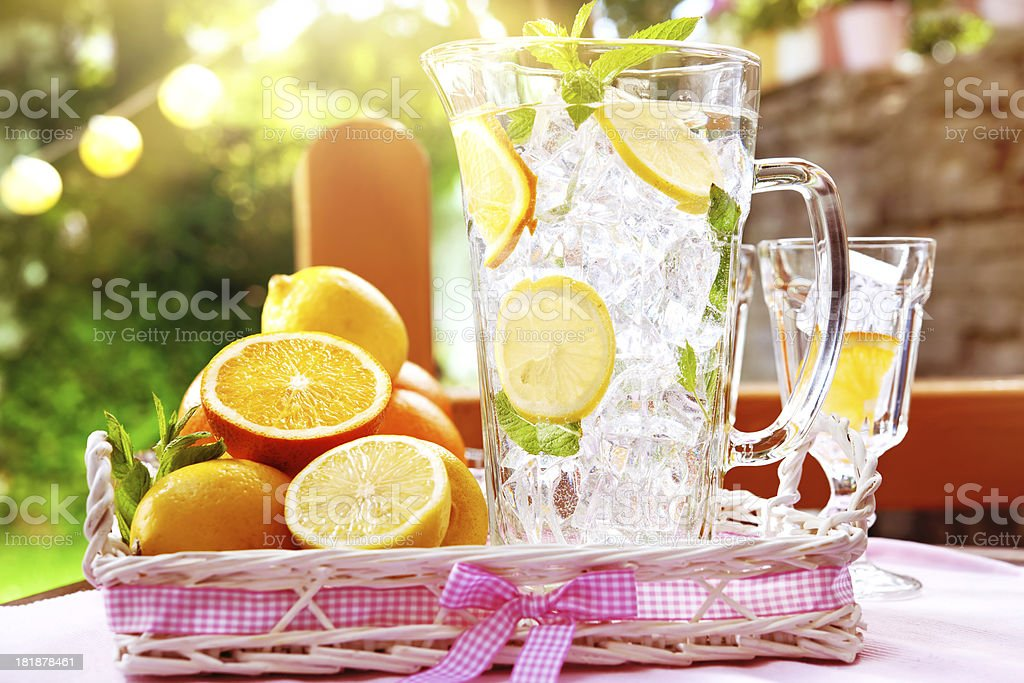 Refreshing water with ice and citrus fruit slices royalty-free stock photo