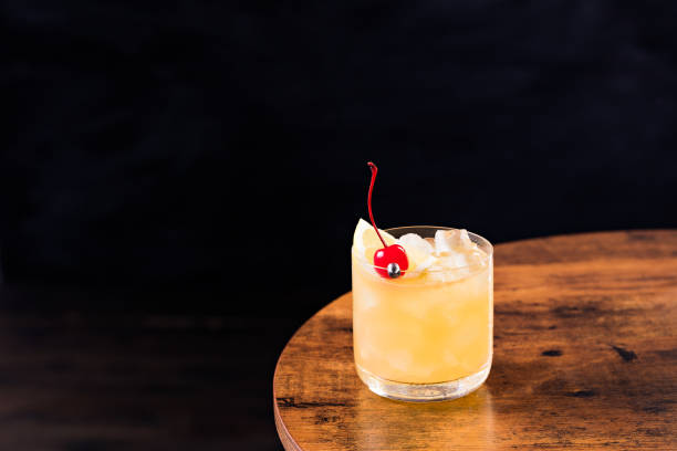 Refreshing Whiskey Sour Cocktail Refreshing Whiskey Sour Cocktail on a Table sour taste stock pictures, royalty-free photos & images