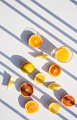 Refreshment drinks on astone table . Summer tropical mood with artistic geometric shadows. Still life and lifestyle concept