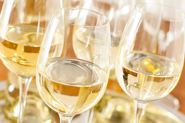 Refreshring White Wine in a Glass Refreshring White Wine in a Glass on a Background white wine stock pictures, royalty-free photos & images
