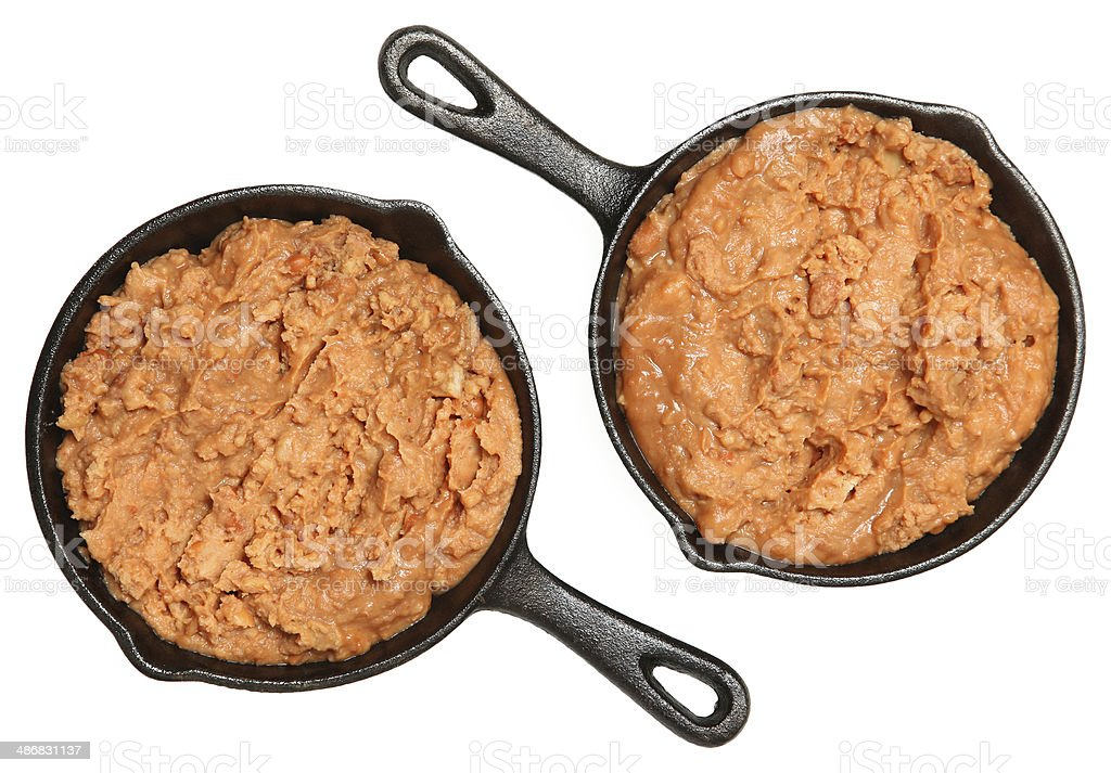 Refried Beans in Skillets Over White stock photo